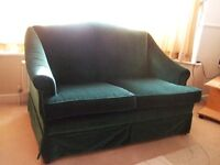 Small Dark Green Velvet Sofa. Parker Knoll.Price includes set of stretch covers. Excellent condition