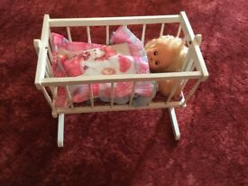 Wooden toy cot.