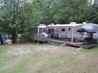 Trailer on beautiful lot **deck, gazebo, shed, etc included**
