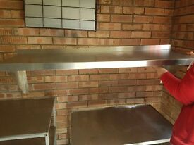Stainless steel tables, sink and shelf
