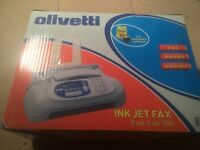 Fax machine still in original box with instructions