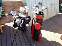 2 bags with clubs for sale