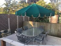 Patio table, 6 chairs and a large parasol