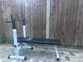 Foldable bench with Dip station. Including bar and weights.