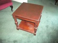 Small occasional table with bottom shelf.