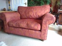 Snuggle Sofa, claret/burgundy colour, textured pattern. Stylish, comfy, seats 2