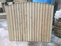 Arch top feather edge fence panels pressure treated green