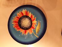 Large serving bowl sunflower design on blue background