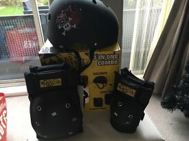 Darkstar helmet, knee pads and elbow pads 3 in 1 set with box.Helmet only worn twice pads never worn