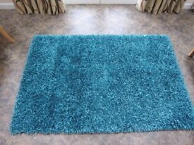 Quality rug purchased from Gillies of Broughty Ferry in teal 1.2m x 1.8m in excellent condition
