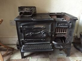 Antique stove/oven. Needs some restoration for heating but would also make a stunning feature piece