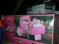 Barbie motor home and dolls