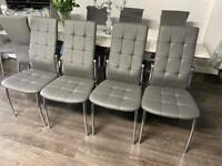 Brand new stylish 4 grey leather chairs