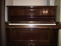 Beautiful upright family heirloom piano for sale.