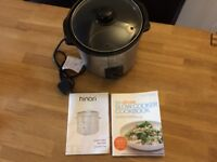 Slow cooker with recipe book
