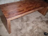 A nice rustic wooden coffee table.