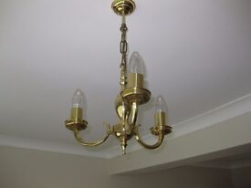 Ceiling lights, brass coloured, candle light; two for sale.