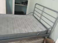 Metal framed double bed with wooden slats with mattress