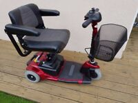 Red 3 wheel mobility scooter