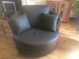 Brown leathers swivel cuddle chair
