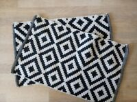 Two black and white rugs