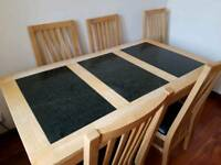 solid wood and granite table with 6 chairs