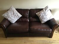 Dark brown leather sofa and matching chair