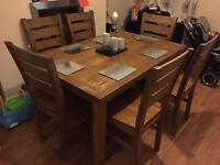 Large heavy wooden dinning table