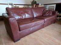 Dark burgundy leather sofa