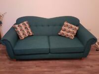 Deep teal colored 3-seater sofa from Sofology.
