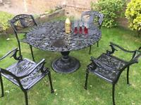 Cast iron garden table & chairs