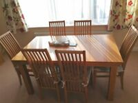 Wooden extendable table and six chairs on sale for only £400