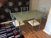 Chrome dining table with glass top (4 matching chairs)