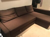 Brown corner sofa-bed with storage - collection only