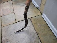 Genuine, unique and very old farmer's scythe on wooden pole