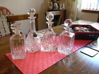 four crystal decanters