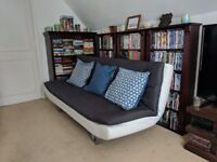 Sofa bed, grey and white in colour (£50)