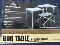BBQ/CAMPING TABLE WITH SIDE SHELVES. MAKER WYNNSTER.