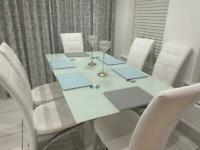 Glass dining table and 6 chair set