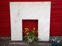 White polished marble fire surround with slight lines of colour in excellent condition.