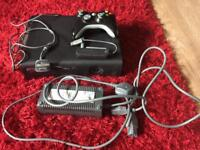 Xbox 360 with controller and network adapter