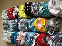 28 used Cloth nappies, 3 nappy bags, cheeky wipes with bag and box