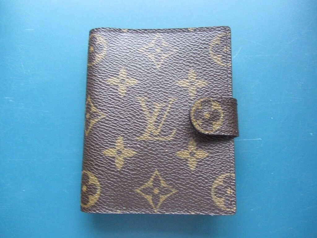 Louis Vuiton card case and pens