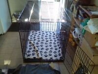 Large dog crate. Excellent condition. 29 inches wide, 42 inches deep, 32 inches high. Hardly used.