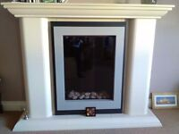 Electric fire in surround.