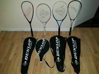 1 mens, 1 woman's tennis racquet. 2 squash racquets with balls.