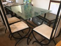 Glass and iron table with 4 chairs