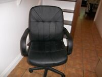 Black Office Chair - Faux leather with arms. Good condition