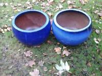 A PAIR OF LARGE BLUE GLAZED CERAMIC POTS