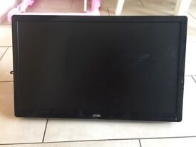 Logik TV 24 inch with remote and wall bracket